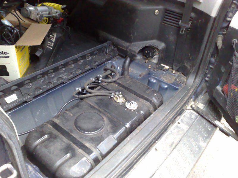 Дополнительный топливный бак в багажнике